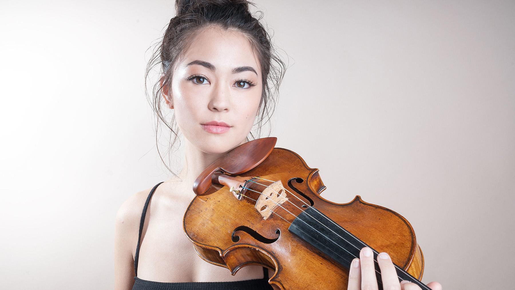 Simone Porter holds her violin